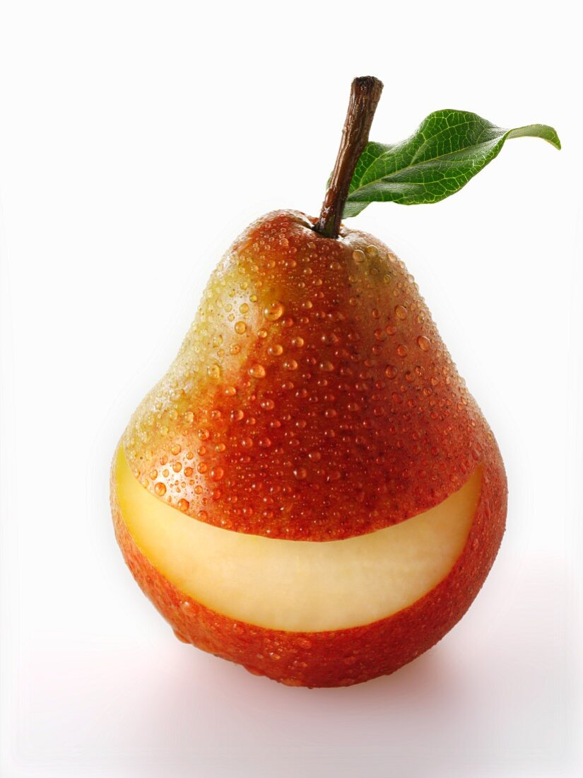 A red pear with a slice taken out of it