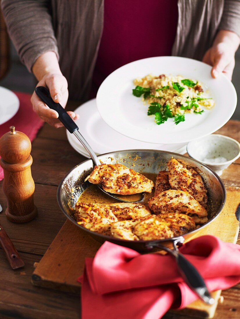 Chicken breast with orange and mustard sauce and couscous