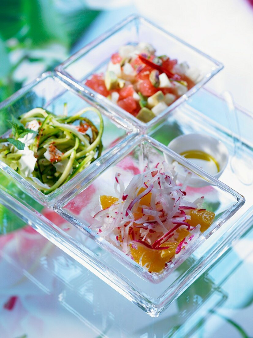Various salads (radish and orange, courgette and mint, avocado and tomato)