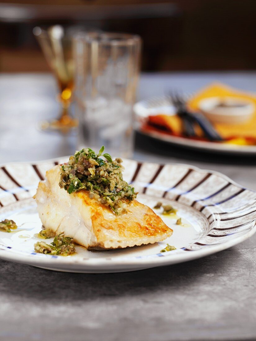Grilled fish with anchovy and herb sauce