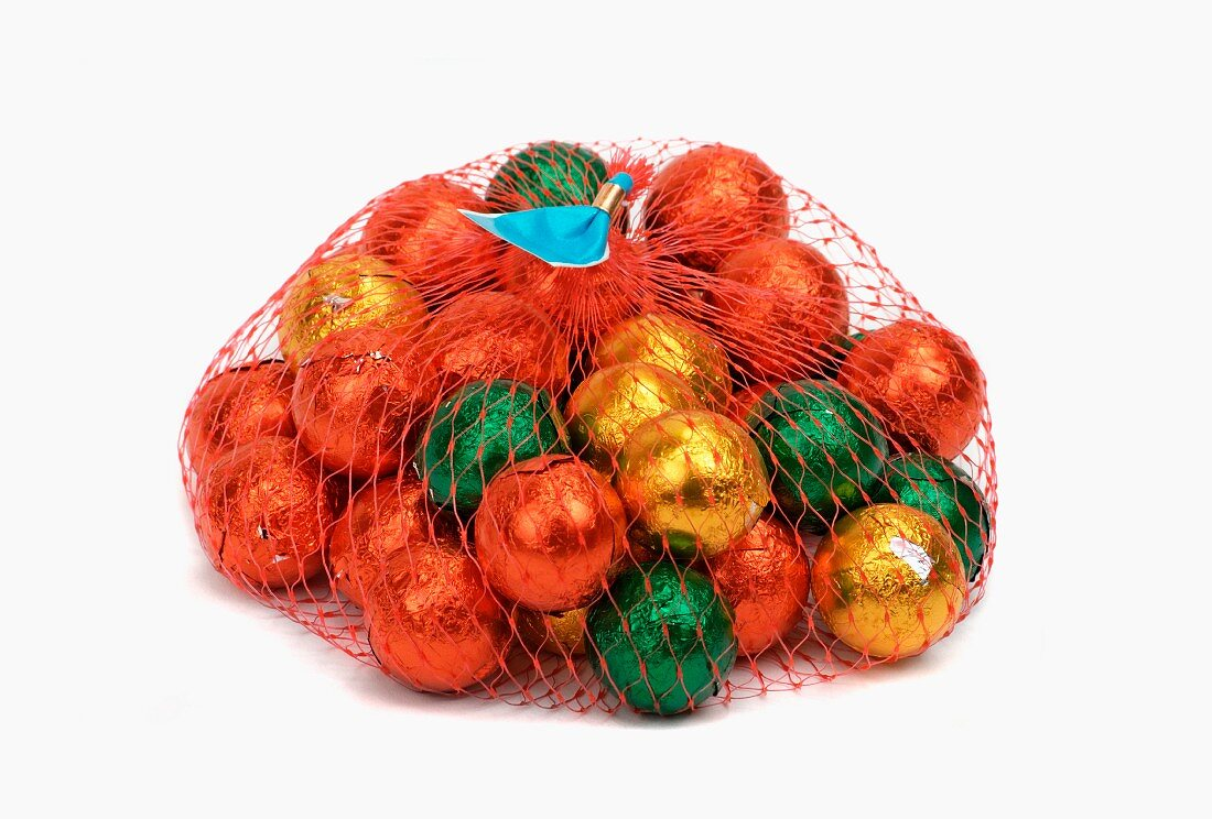 Chocolate balls, wrapped in foil, in a mesh bag