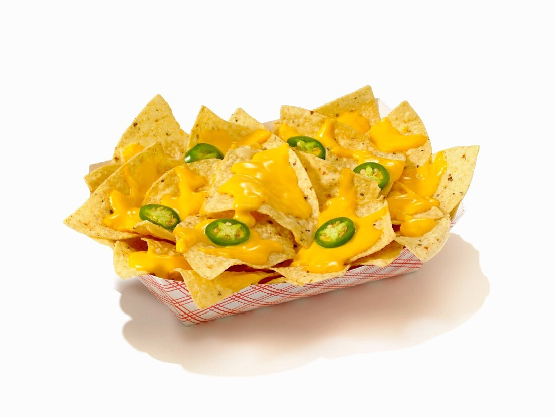 Nachos with Cheese Sauce and Sliced Jalapenos in a Take Out Container