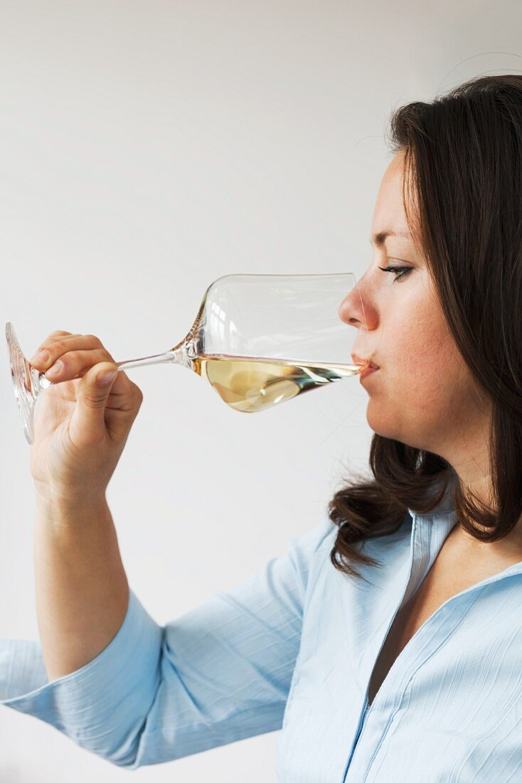 Woman drinking a glass of white wine
