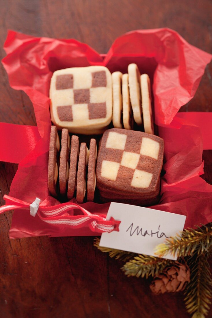 Black and white biscuits in a box as a gift