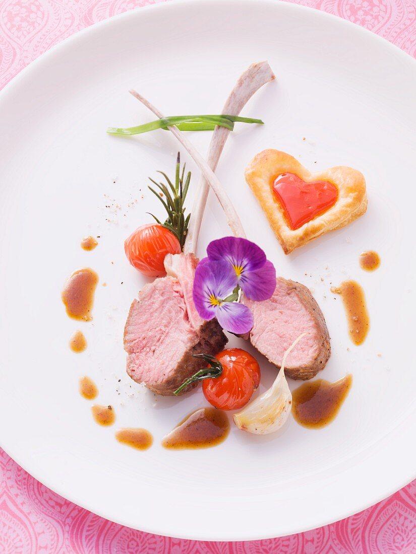 Medium rare lamb chops with heart-shaped puff pastries