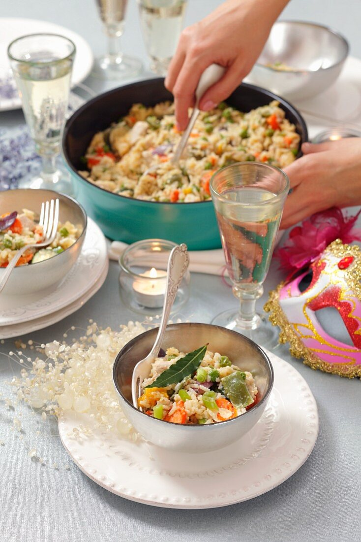 A rice dish with turkey and vegetables