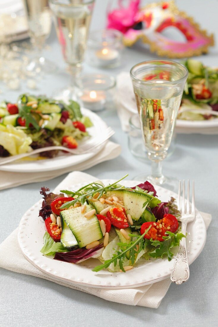 Courgette salad with cherry peppers, pine nuts and rocket