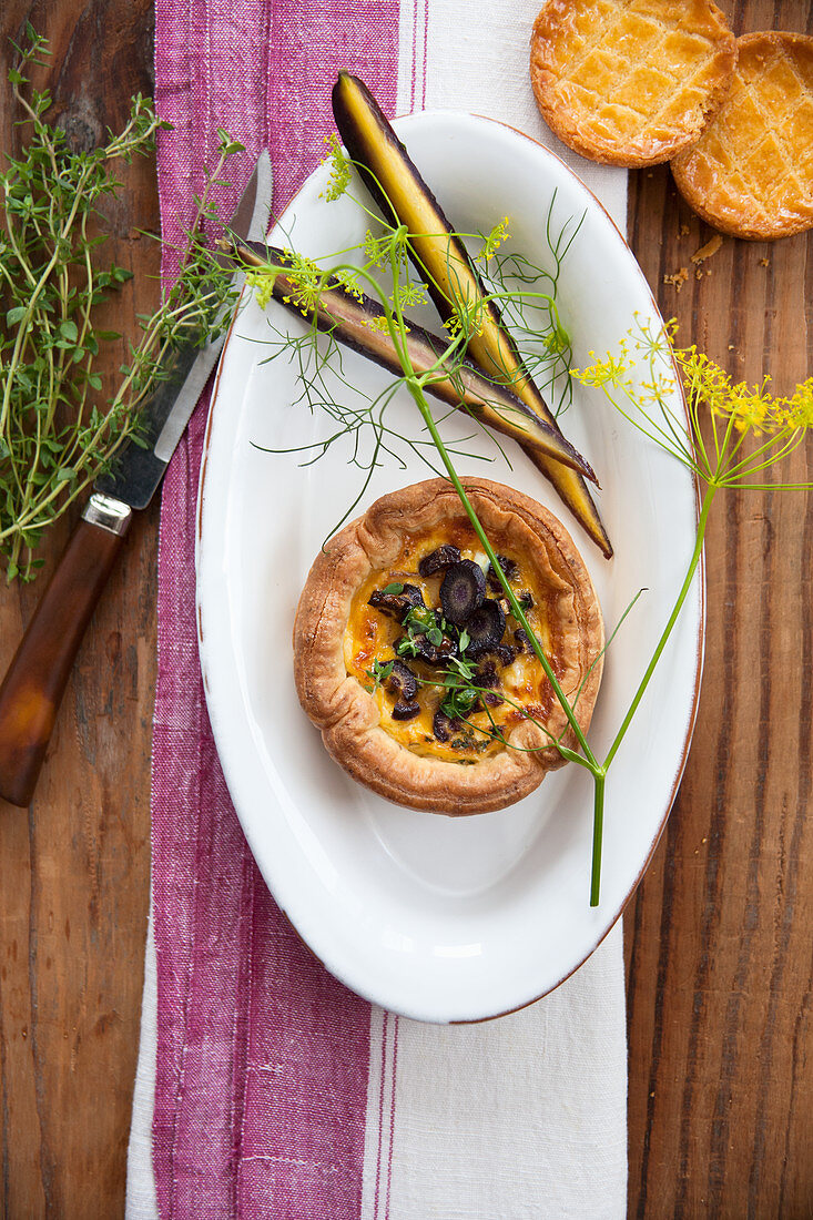A mini quiche with purple carrots