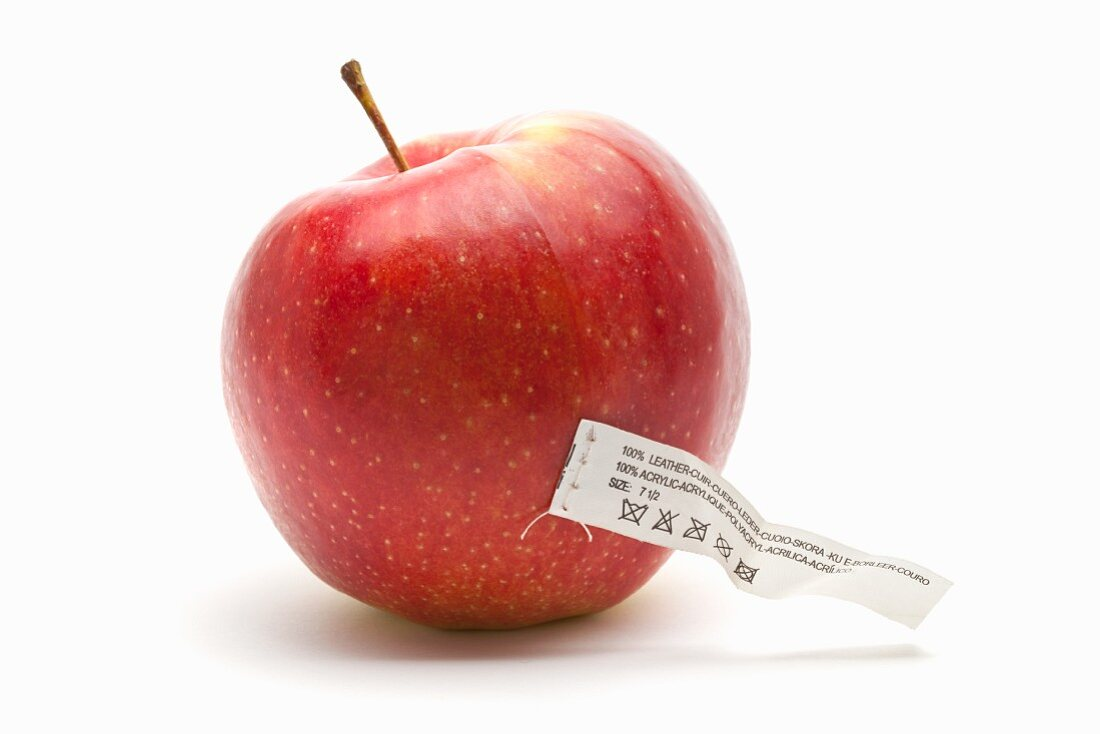 An apple with a care label (an icon for synthetically created food)