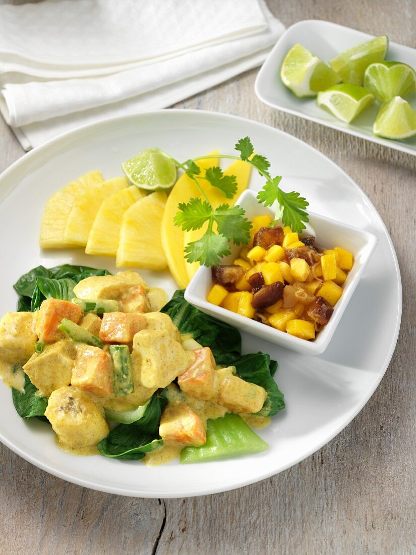 Curried Chicken with Sweet Potatoes and Bananas; Fresh Pineapple Slices