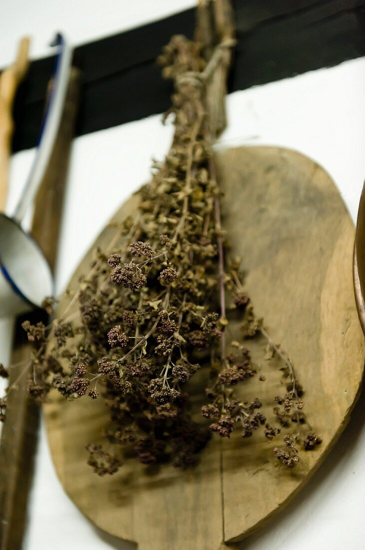 Dried herbs and an old wooden board hanging on a wall