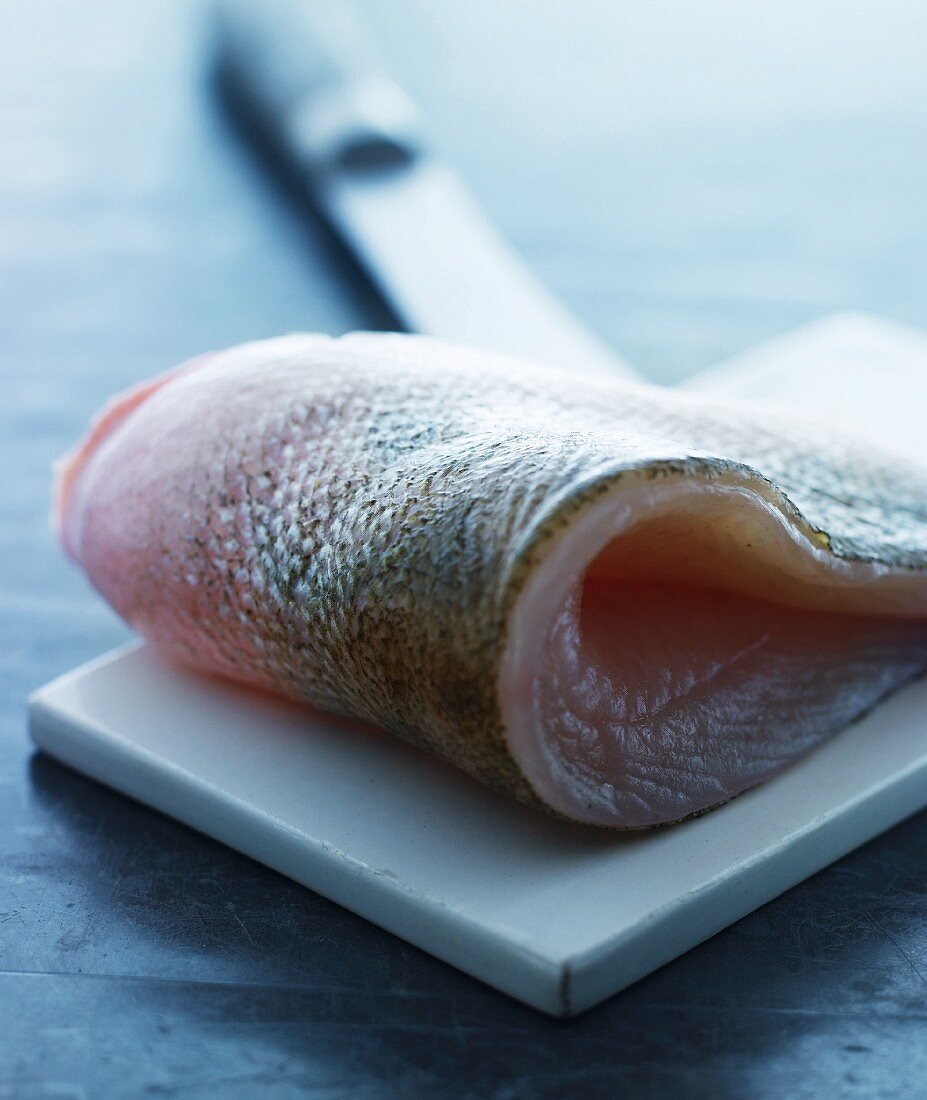 Cod fillet on a chopping board