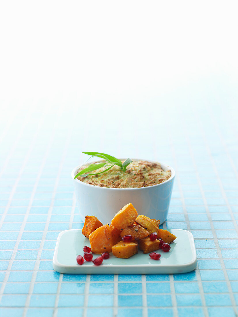 Baked butternut squash with pomegranate seeds and fish farce
