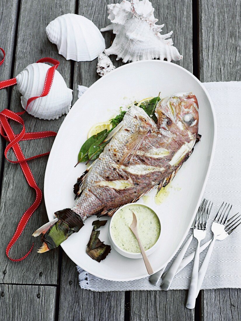 A whole red snapper with onion mayonnaise