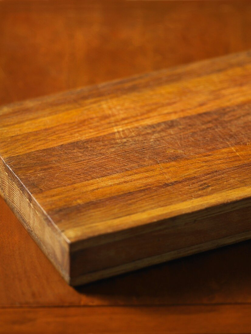 A chopping board on a wooden table