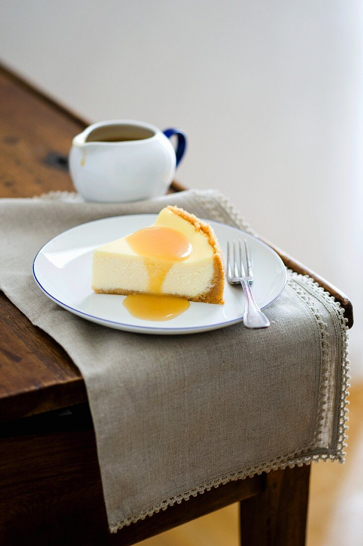 A slice of cheese cake with whiskey cream