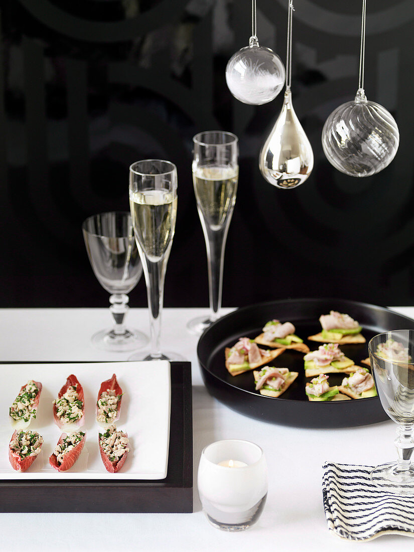 Tuna and avocado canapes and chicken salad served in red chicory leaves