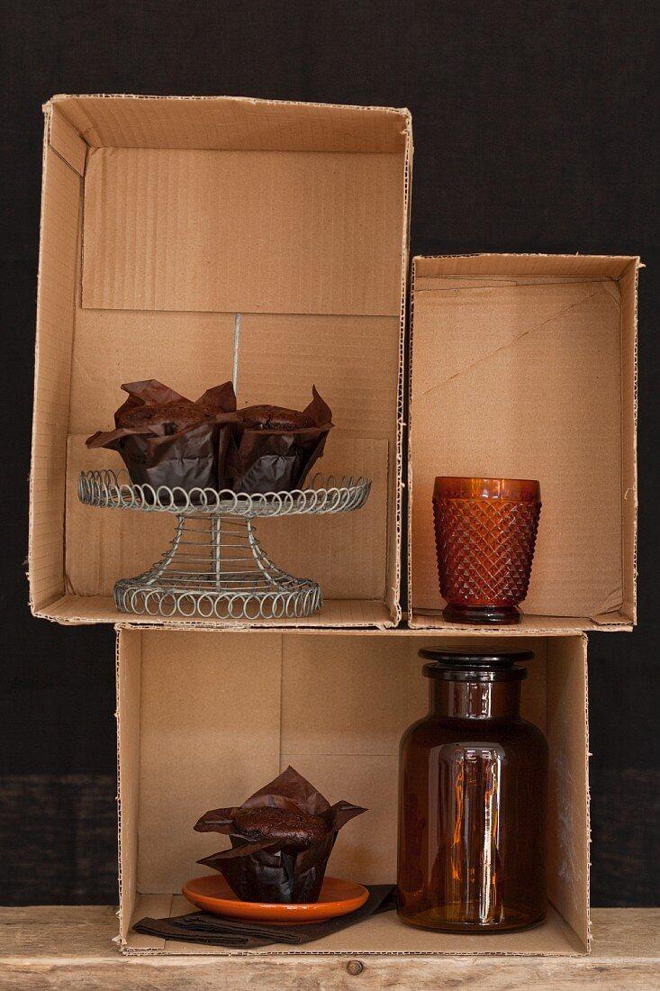 Chocolate cake displayed in cardboard boxes