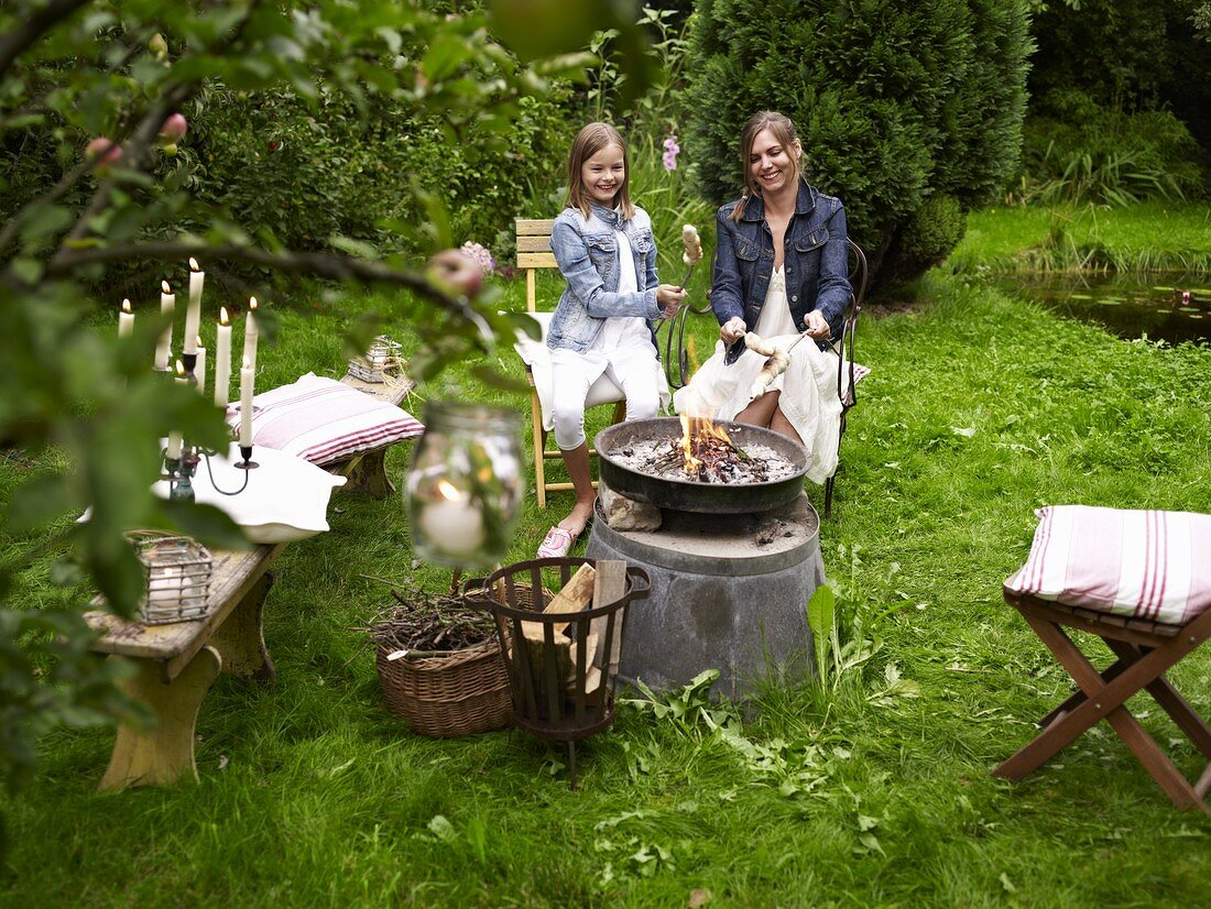A mother and daughter having a barbecue