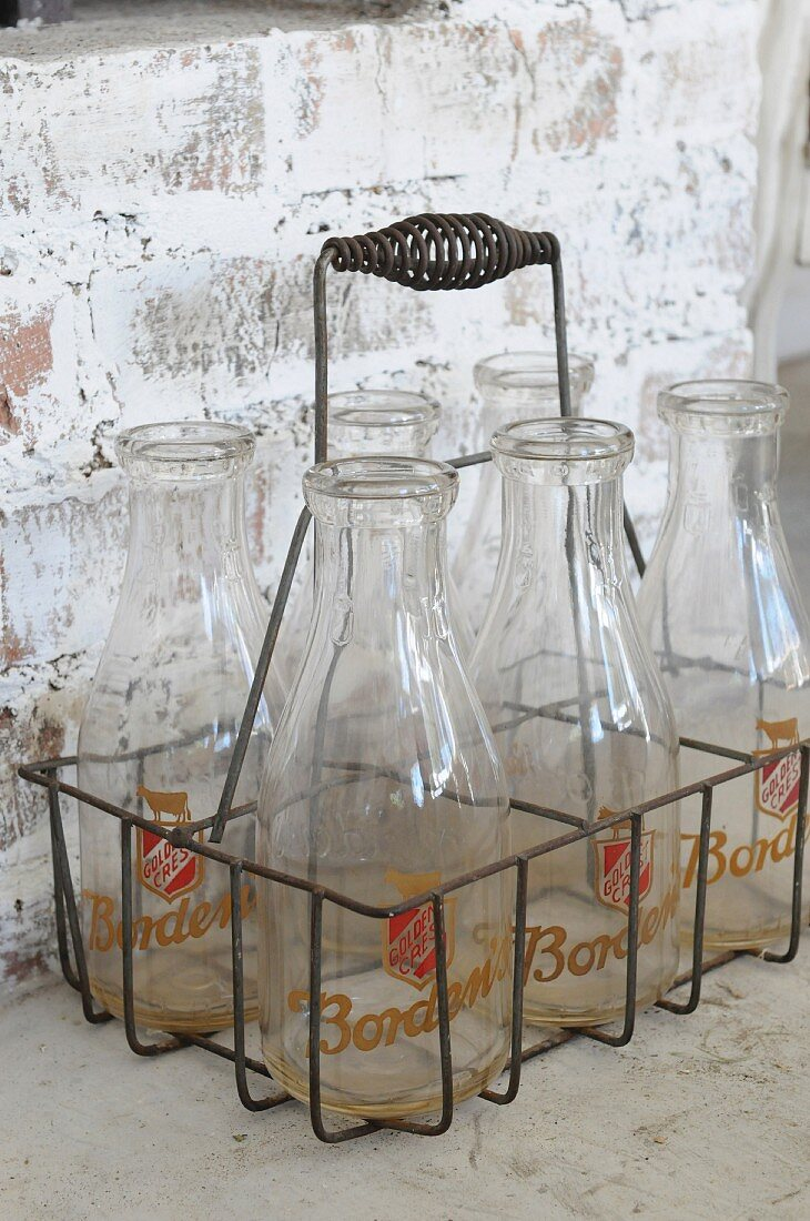 Empty milk bottles in a bottle carrier