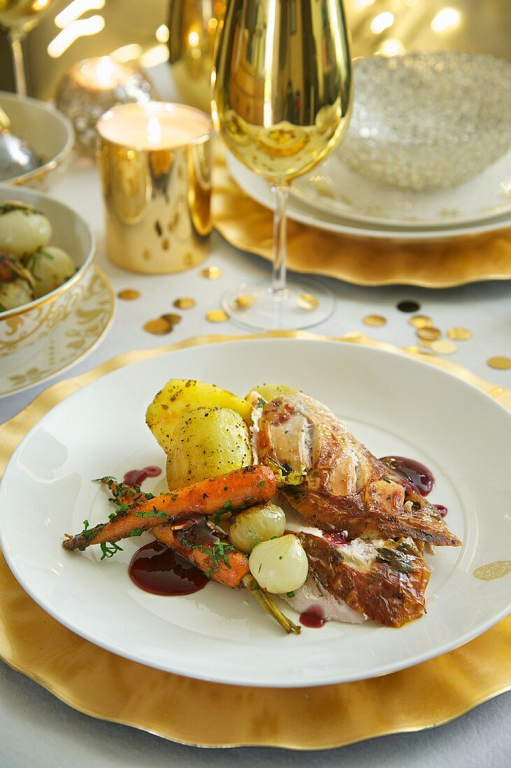 Stuffed turkey with oven roasted vegetables and sauce