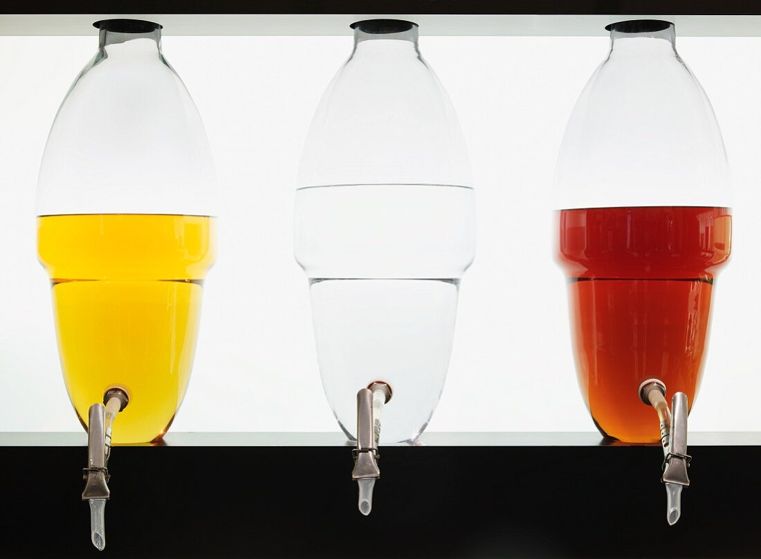 Spirits of different colors in glass containers : single malt, gin, brandy