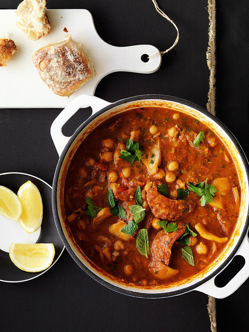 Chickpea soup with chorizo and squid