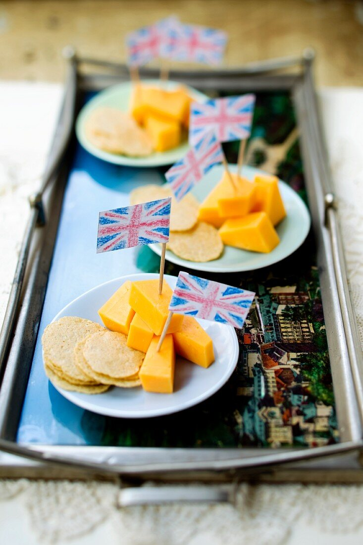 Cheddar cheese on sticks with Union Jacks and crackers