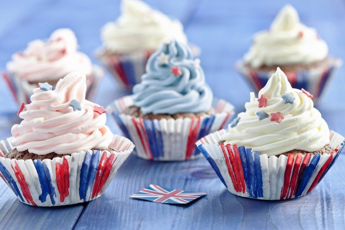 Chocolate cupcakes topped with coloured cream