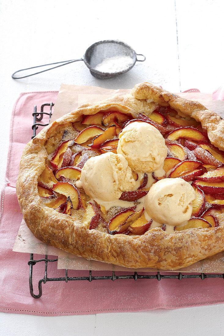 Nectarine and almond tart with vanilla ice cream