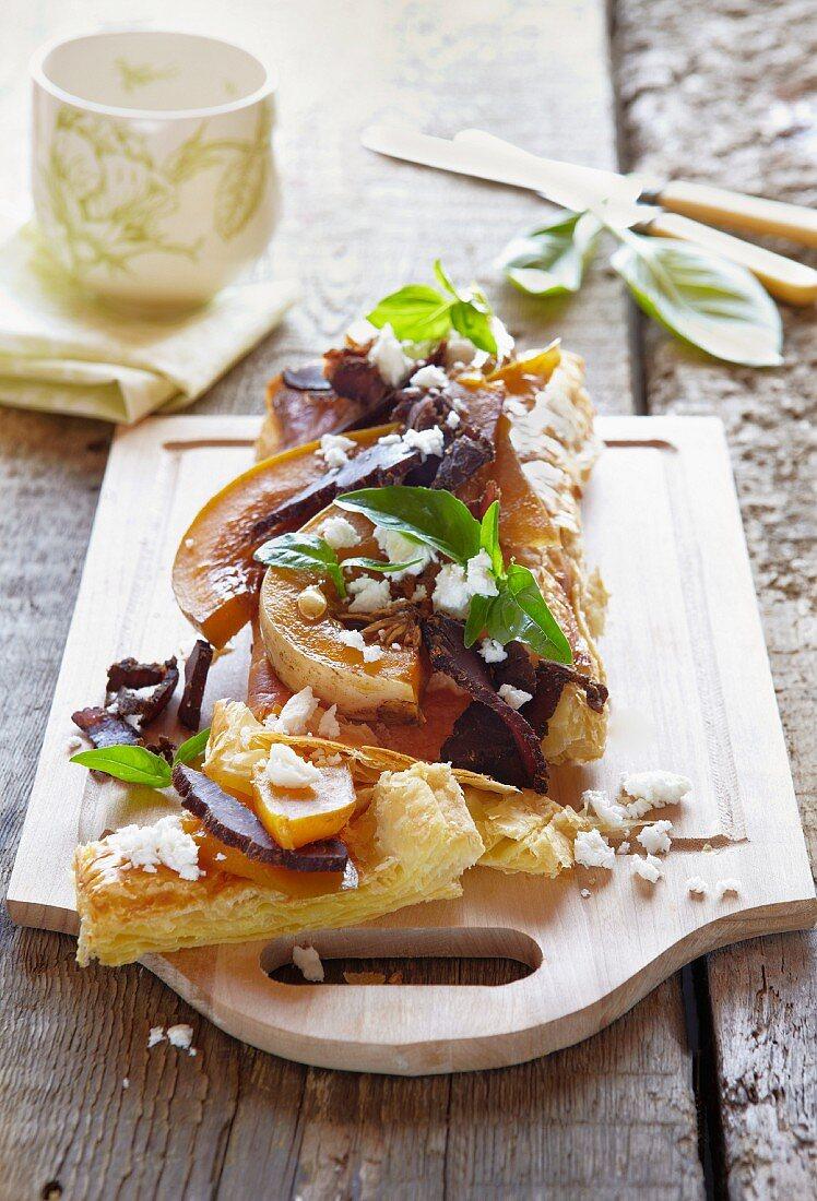 A caramelised pumpkin, feta and ham tart