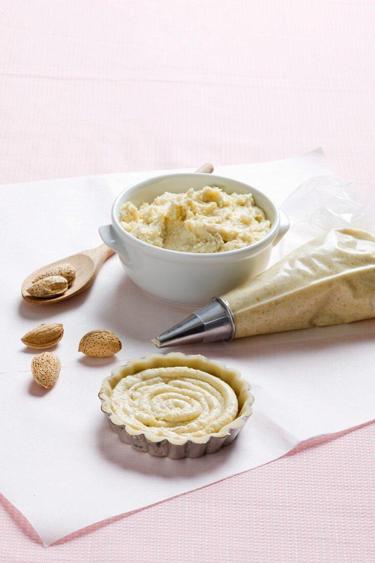 An almond tart being made