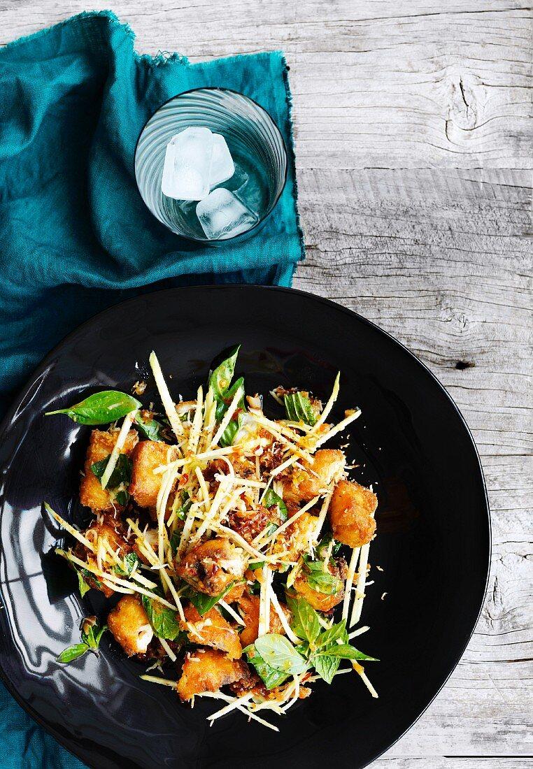 Fish, mango and coconut salad