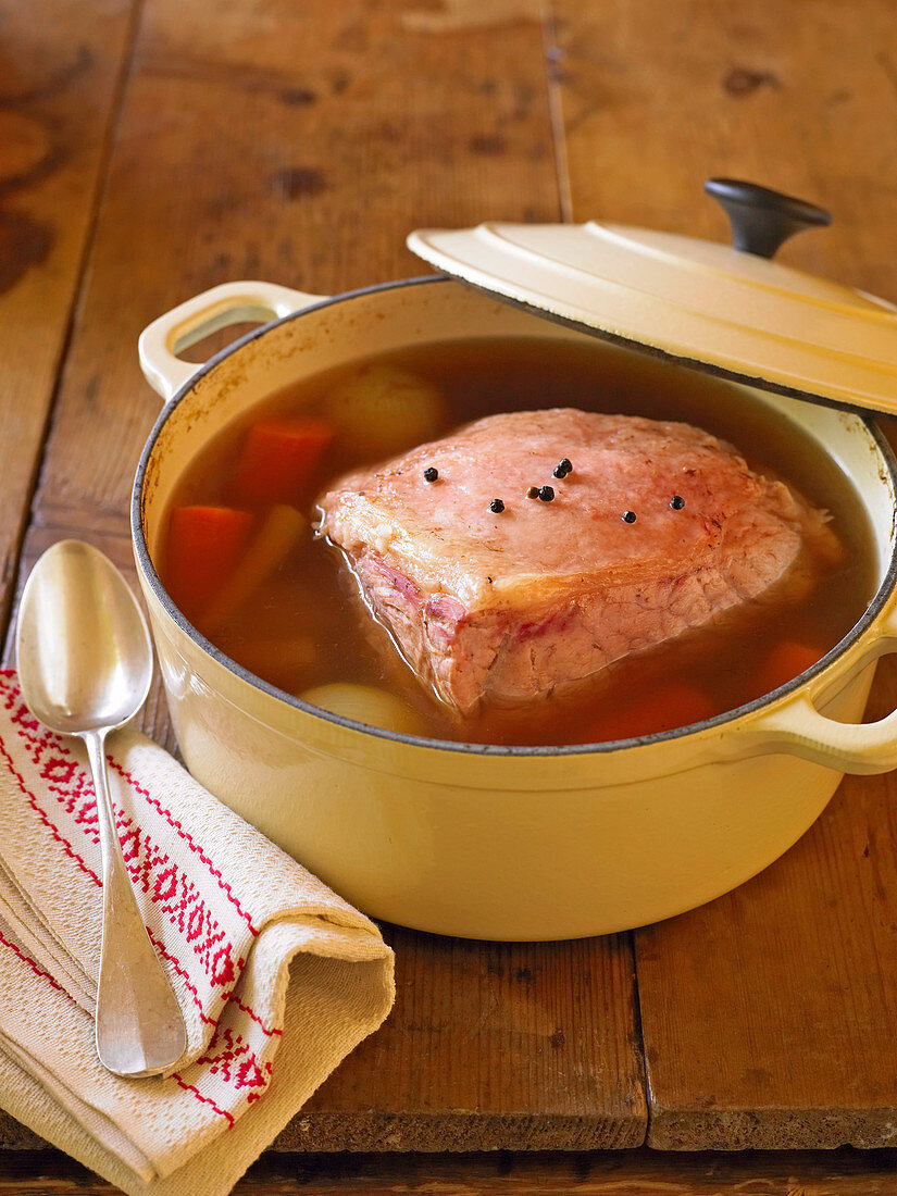 Cooked corned beef in vegetable stock