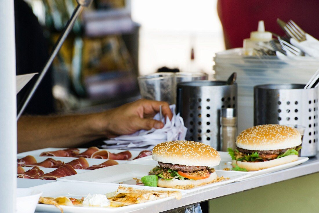 Hamburgers freshly prepared by cook waiting to be served to customers