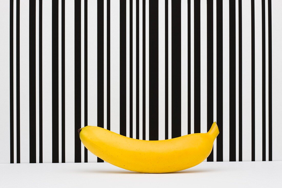 Food concept, banana in front of bar code