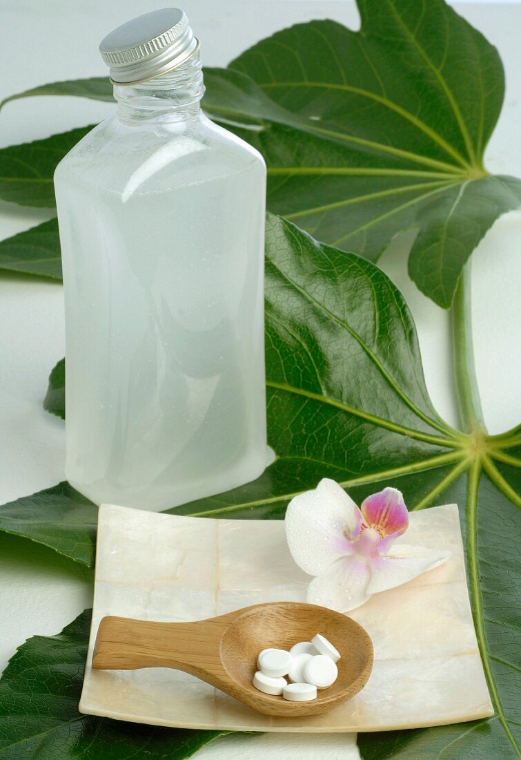 Tissue salts, leaf, bottle and orchid blossom