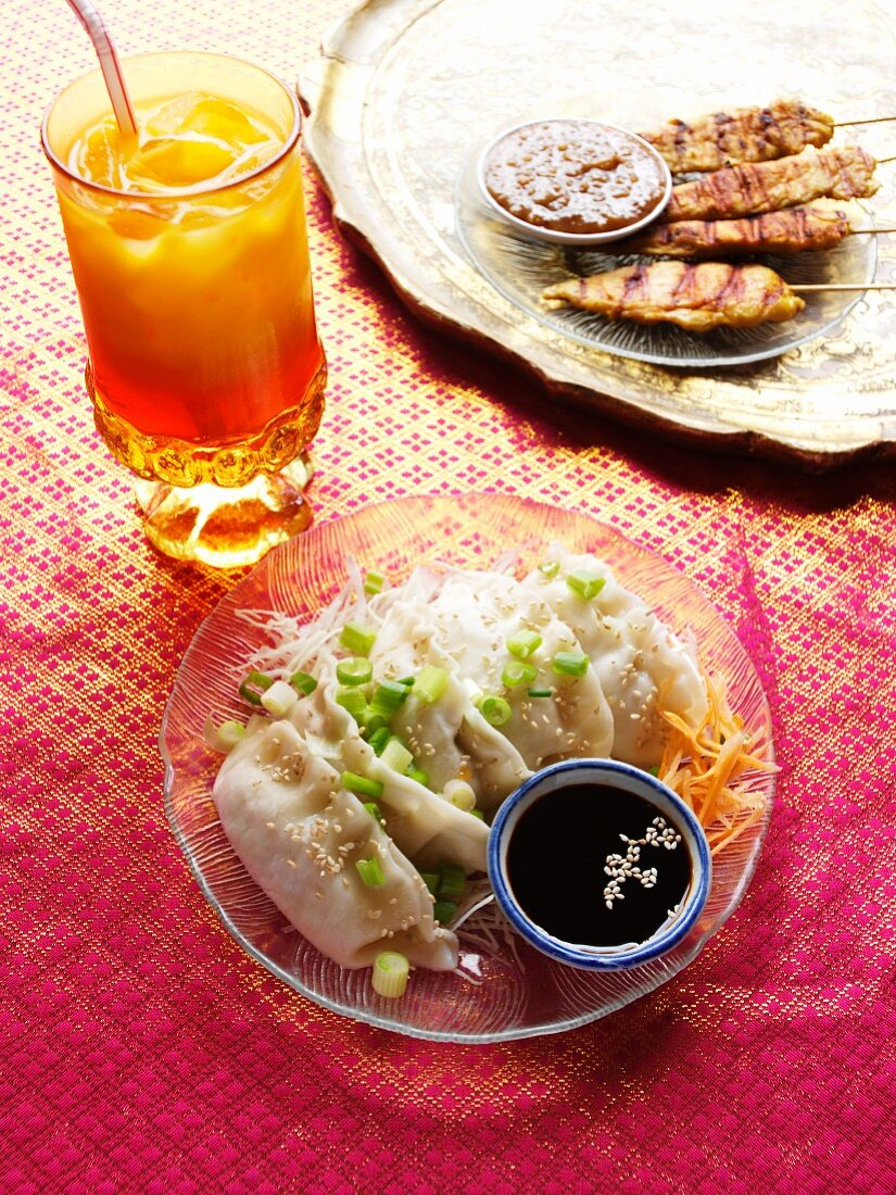 Dim Sum; Asian Dumplings with Soy Sauce and Chicken Satay