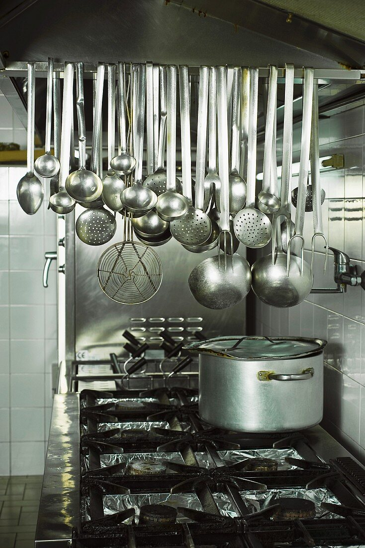 Kitchen Utensils Above A Cooker In A License Images 11085745 Stockfood