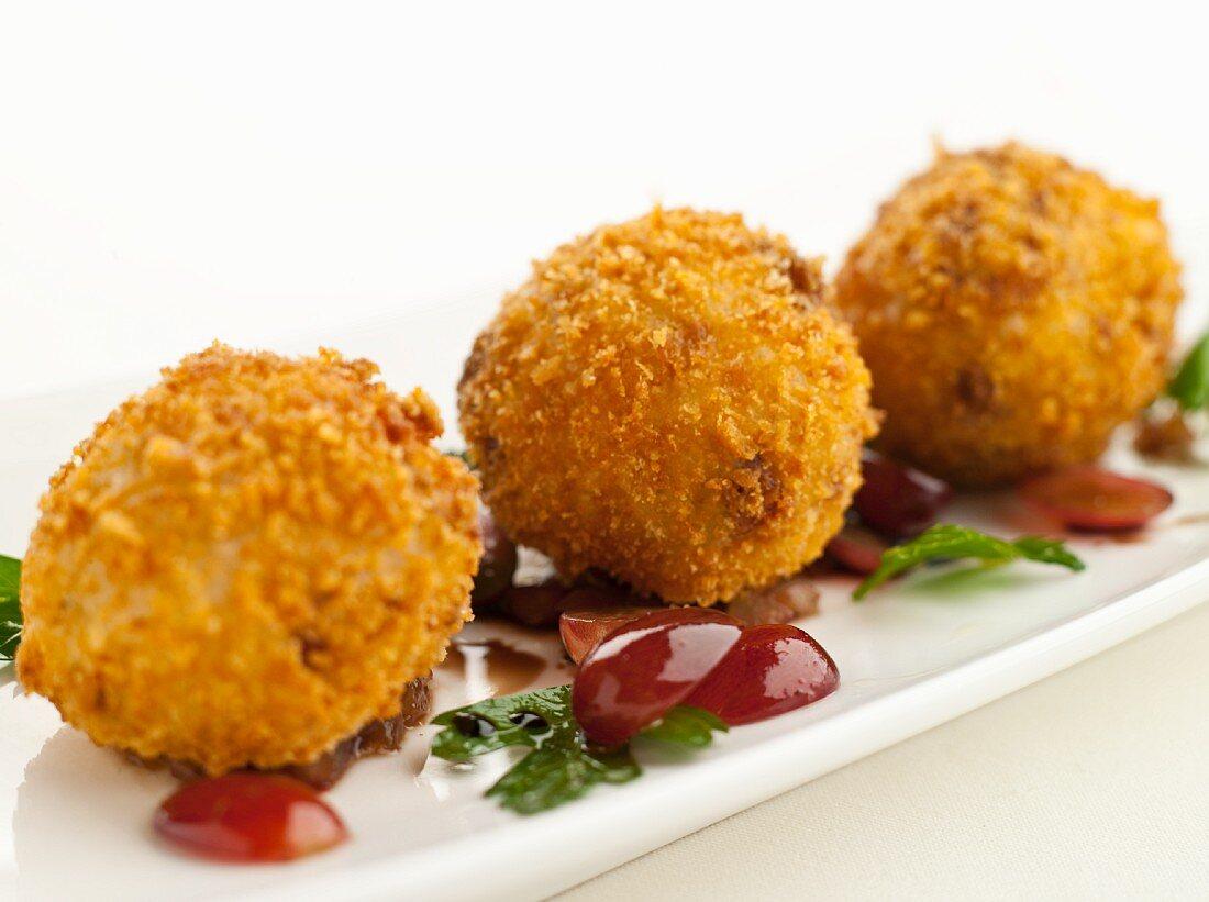 Arancini (breaded and fried rice balls, Italy)
