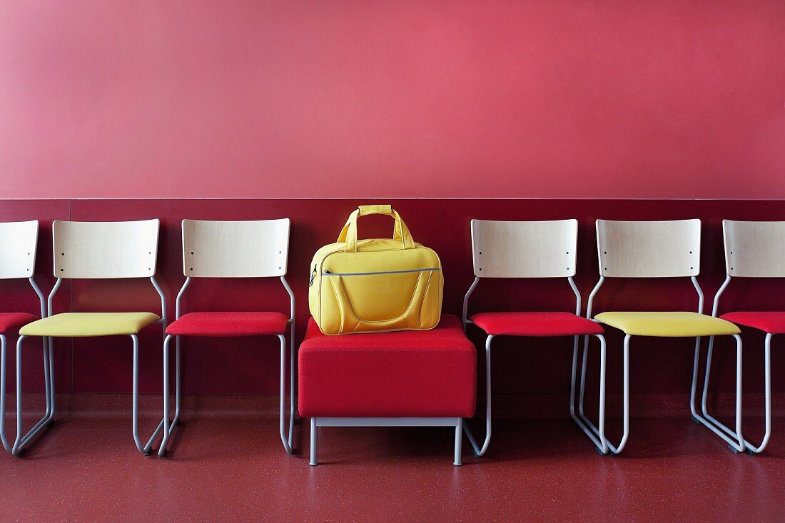 Chairs and a yellow bag in a waiting room