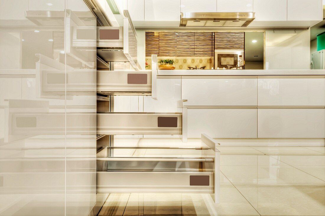 Open drawers in a fitted kitchen