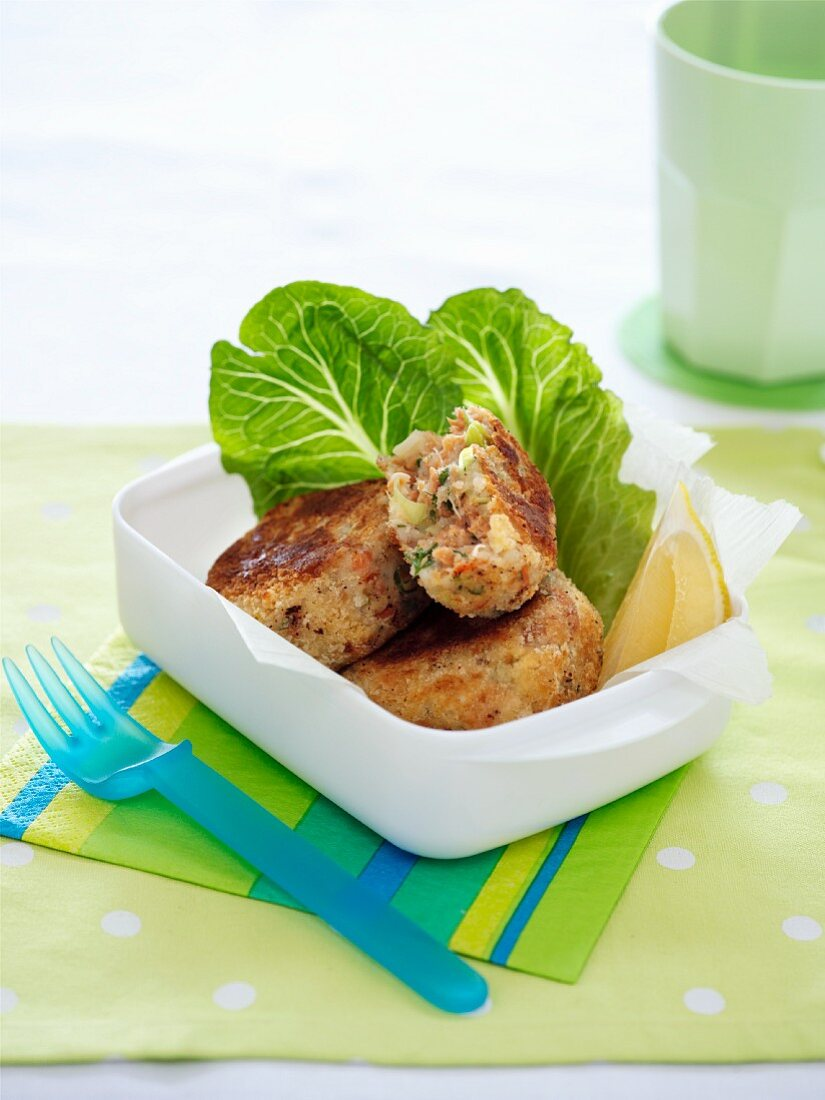 Salmon burgers in a lunchbox