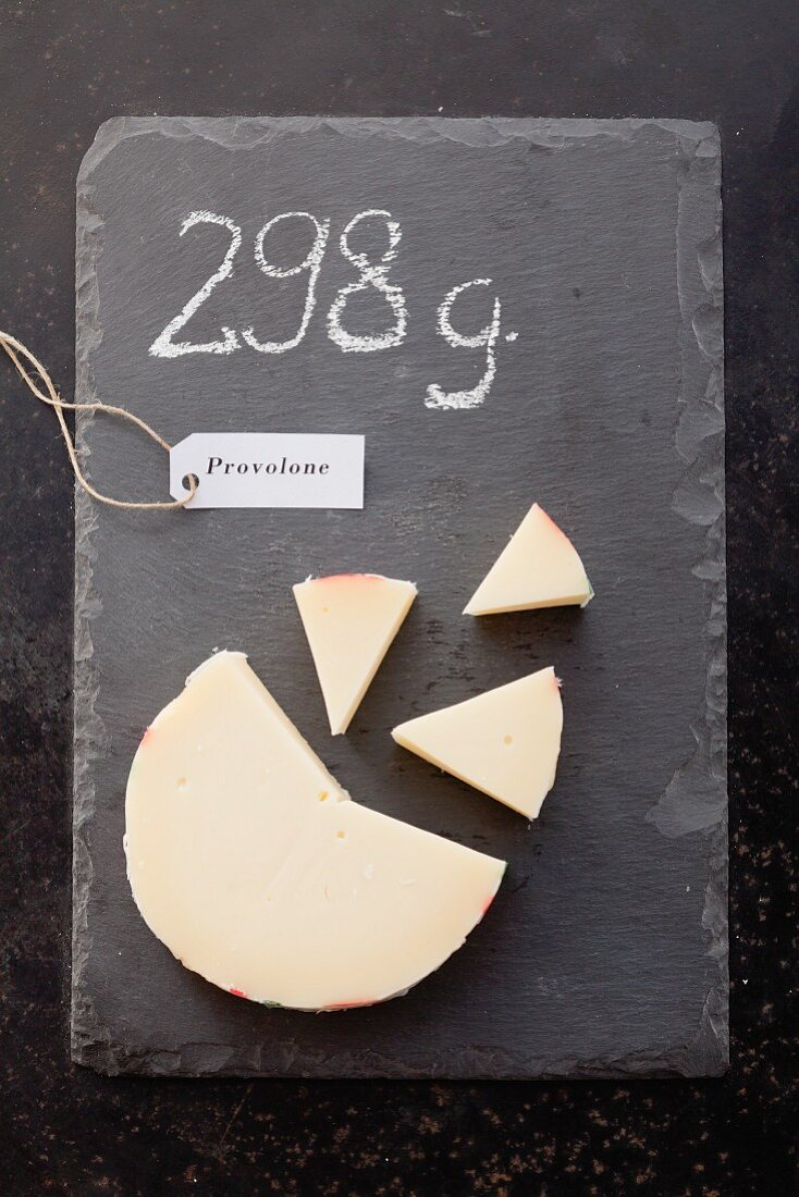 Provolone with a label and its weight