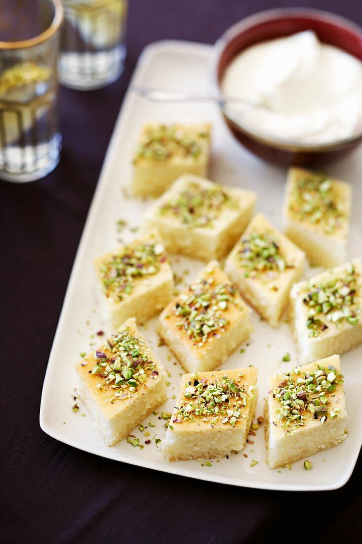 Semolina-yogurt cake with pistachios cut into slices