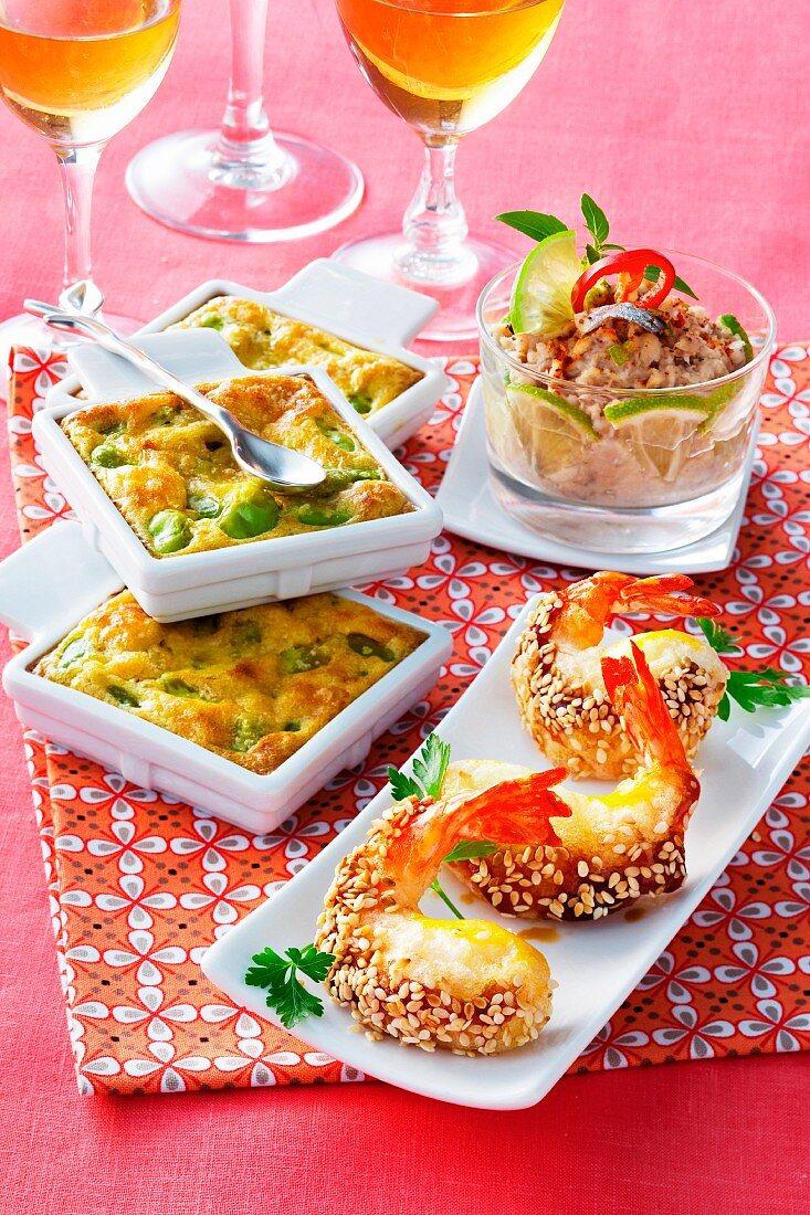 Fava bean clafoutis, sardine cream and honey and sesame prawns