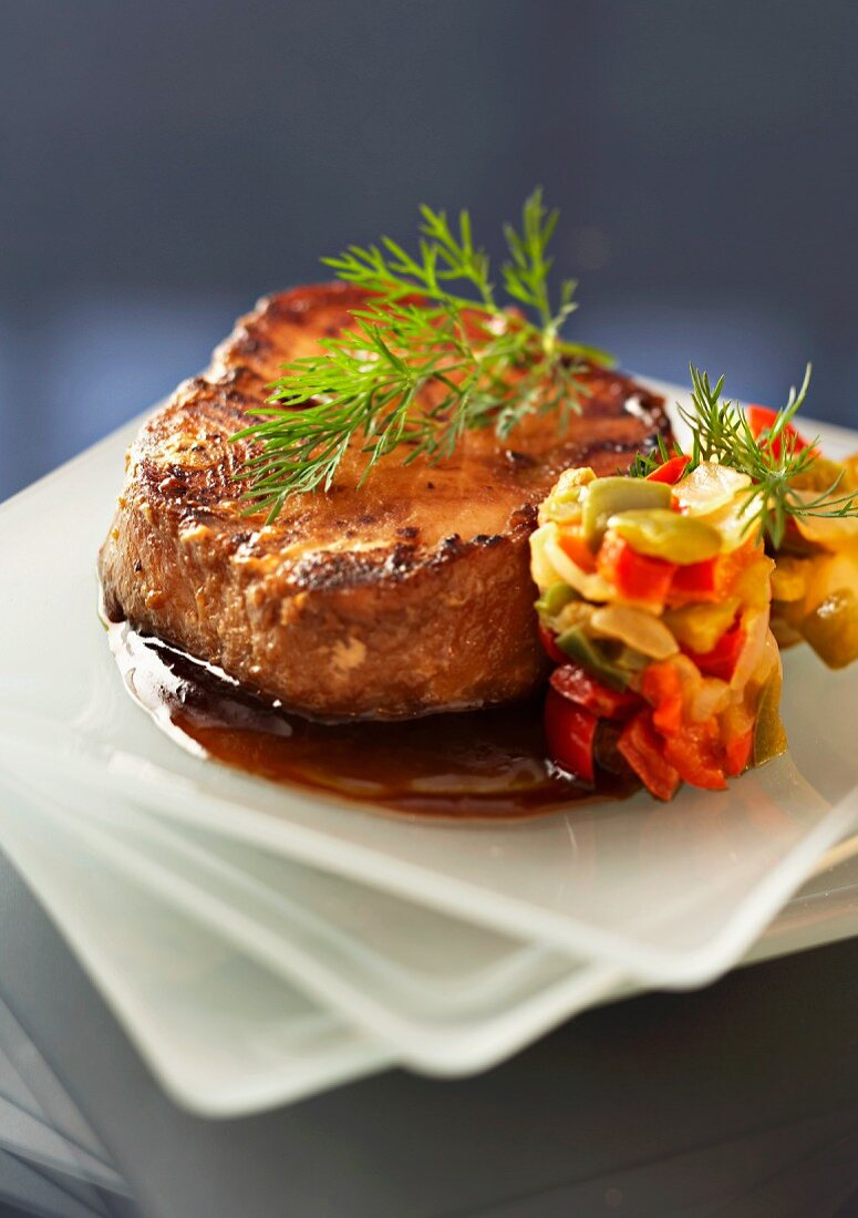Tuna steak with pepper sauce and vegetable tartar