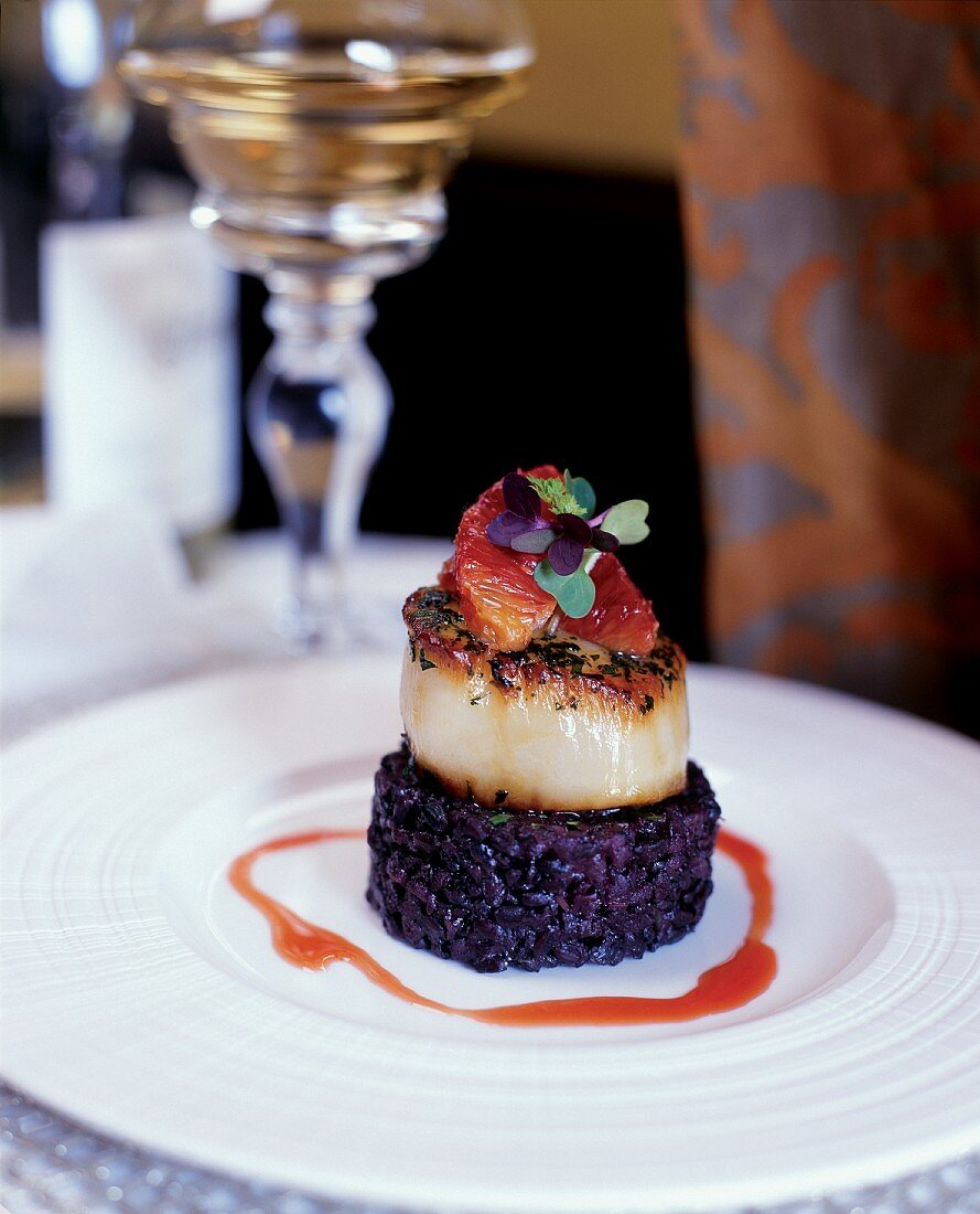 Seared Scallop with Blood Orange Sauce and Black Rice Gallette