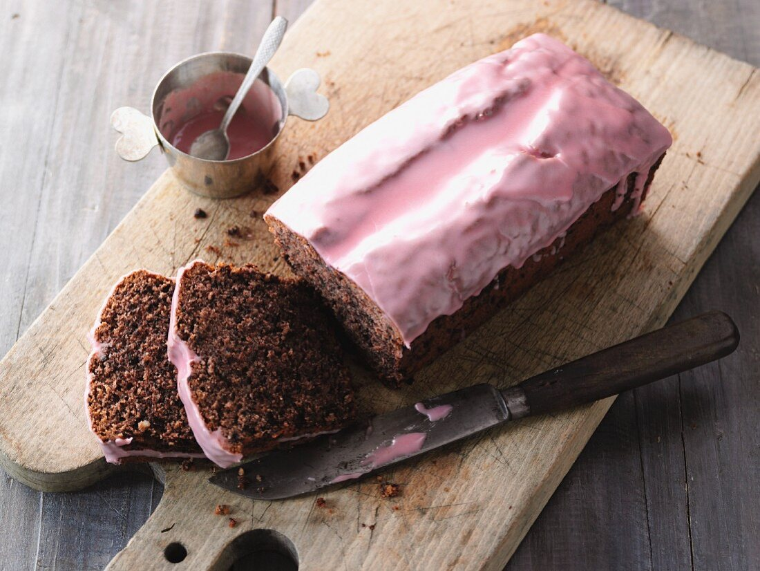 Red wine cake with nuts and pink frosting
