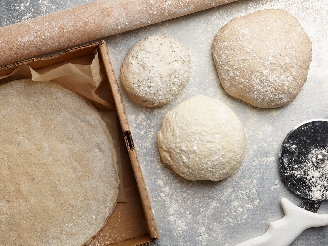 Pizza dough in balls and rolled out